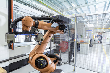 Robotics engineer operating robot aided CNC machine in robotics research facility - CUF00016