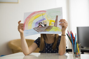 Little girl hiding behind her drawing - LVF06920