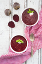 Beetroot soup in bowl on white wood - LVF06923