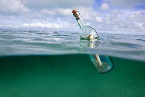 Message in a bottle floating in ocean - CUF00496