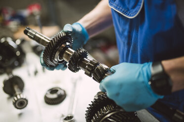 Close-up of mechanic working on the parts of a car in a workshop - RAEF02016