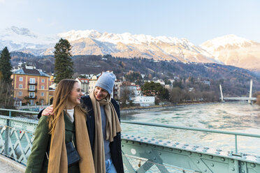 Austria, Innsbruck, happy young couple strolling together in winter - WPEF00223