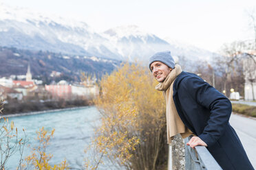 Austria, Innsbruck, portrait of smiling young man looking at distance - WPEF00235