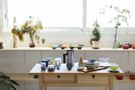 Empty kitchen with dishes on wooden table - EBSF02466