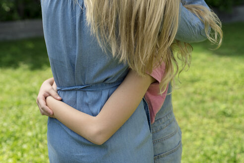 Mother and daughter hugging each other - SBOF01463