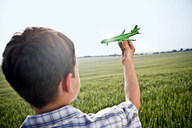 Boy playing with toy plane - CUF00776