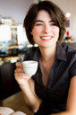 Smiling woman having coffee in cafe - CUF00902