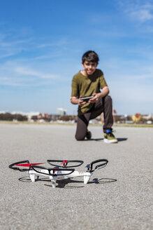 Boy flying drone - DIGF04170