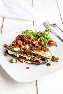Aubergine lasagne on plate, rucola and tomato, vegetarian - SARF03719