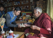 Nepal, Sherpa getting a blessing from moch, before climbing he Mount Everest - ALRF01042