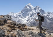 Nepal, Solo Khumbu, Everest, Mountaineer walking at Dingboche - ALRF01057