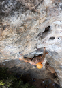 Thailand, Krabi, barechested man climbing in rock wall - ALRF01168