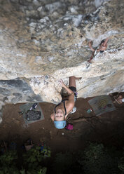 Thailand, Krabi, Railay Beach, woman climbing in rock wall - ALRF01171