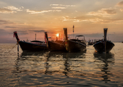 Thailand, Krabi, Railay beach, long-tail boats floating on water at sunset - ALRF01174