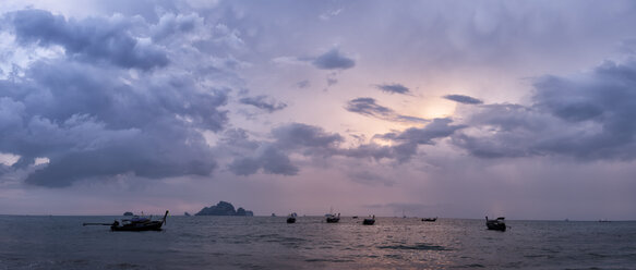 Thailand, Krabi, Tonsai Beach, long-tail boats floating on water at sunset - ALRF01180