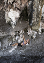 Thailand, Krabi, Lao liang island, woman bouldering in rock wall - ALRF01183