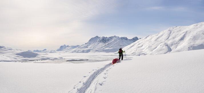 Greenland, Schweizerland Alps, Kulusuk, Tasiilaq, female ski tourer - ALRF01214