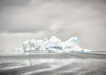 Greenland, Kulusuk, dark clouds over ice iceberg - ALRF01226