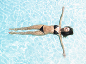 Young woman floating in pool - CUF01086