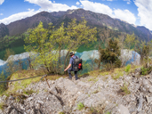 Italy, Lombardy, hiker during descent - LAF02019