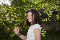 Portrait of laughing girl in the garden - LVF06940