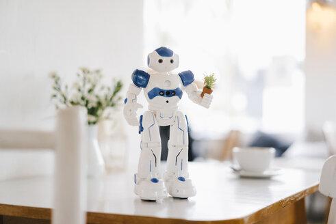 Miniature robot figurine holding flowerpot - KNSF03890