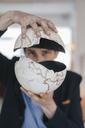 Man holding broken globe - KNSF03896