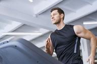 Man running on treadmill at gym - BSZF00307