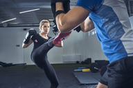 Woman practicing kickboxing at gym - BSZF00361