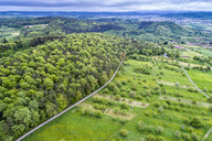 Germany, Baden-Wuerttemberg, Swabian Franconian forest, Rems-Murr-Kreis, Aerial view of meadow with scattered fruit trees and roads - STSF01529