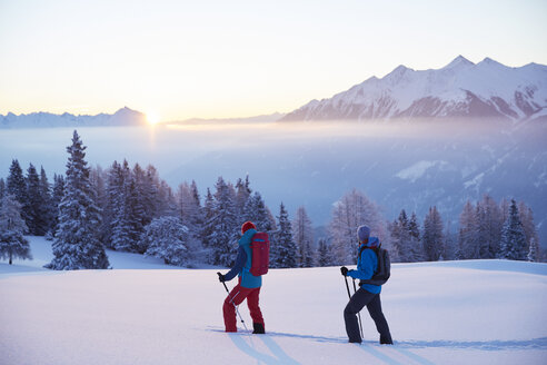 Austria, Tyrol, snowshoe hikers at sunrise - CVF00403