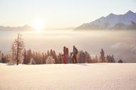 Austria, Tyrol, snowshoe hikers at sunrise - CVF00406