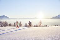 Austria, Tyrol, snowshoe hikers at sunrise - CVF00409