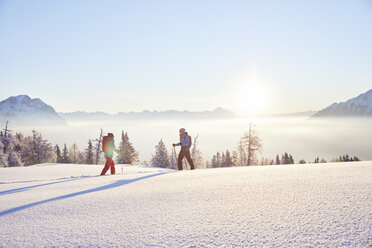 Austria, Tyrol, snowshoe hikers at sunrise - CVF00409