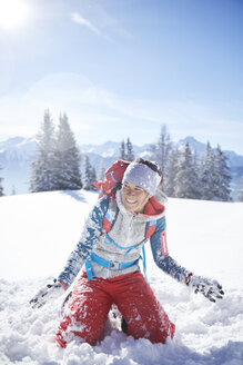 Austria, Tyrol, female hiker having fun in the snow - CVF00433