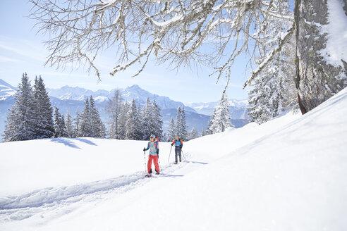 Austria, Tyrol, couple snowshoeing - CVF00436