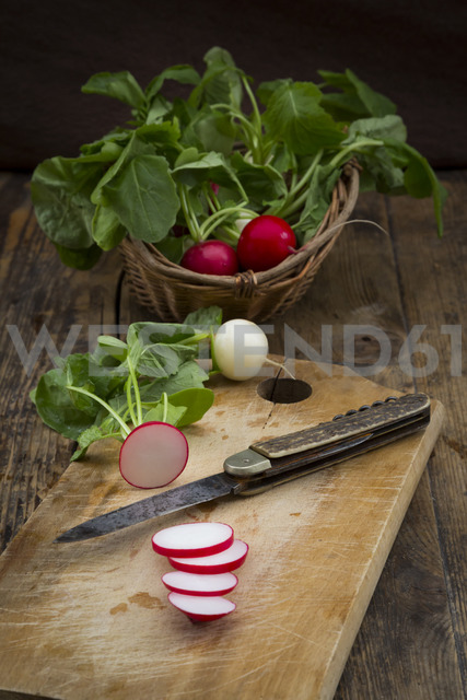 Red and white radish on chopping board - LVF06949