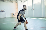 Man playing basketball, indoor - ZEDF01387