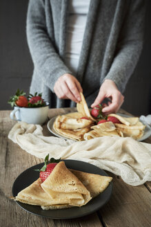 Homemade pancakes with strawberries on plate - BZF00386