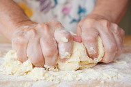 Close up of older woman kneading dough - CUF01513