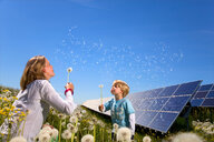 Mother and son with solar panels - CUF01588
