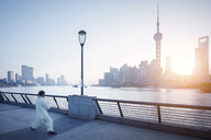 China, Shanghai, Skyline, athlete in the morning - SPP00035