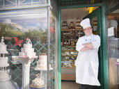 Baker standing in cake shop - CUF01846