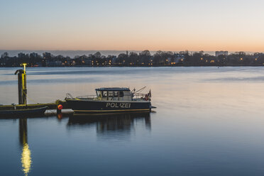 Germany, Hamburg, Outer Alster Lake, mooring area, police boat in the morning - KEBF00816