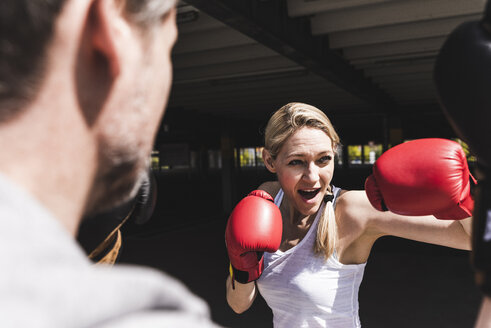 Man and woman in boxing training - UUF13626