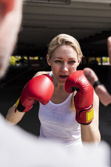 Man and woman in boxing training - UUF13629