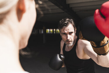 Man and woman in boxing training - UUF13632