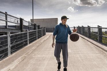 Man dribbling with basket ball - UUF13635