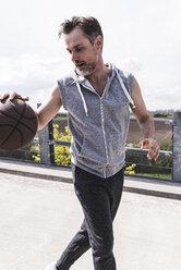 Man dribbling with basket ball - UUF13638
