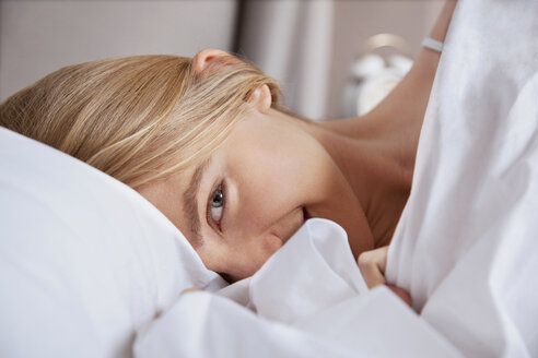Close up of young woman in bed - ISF00859